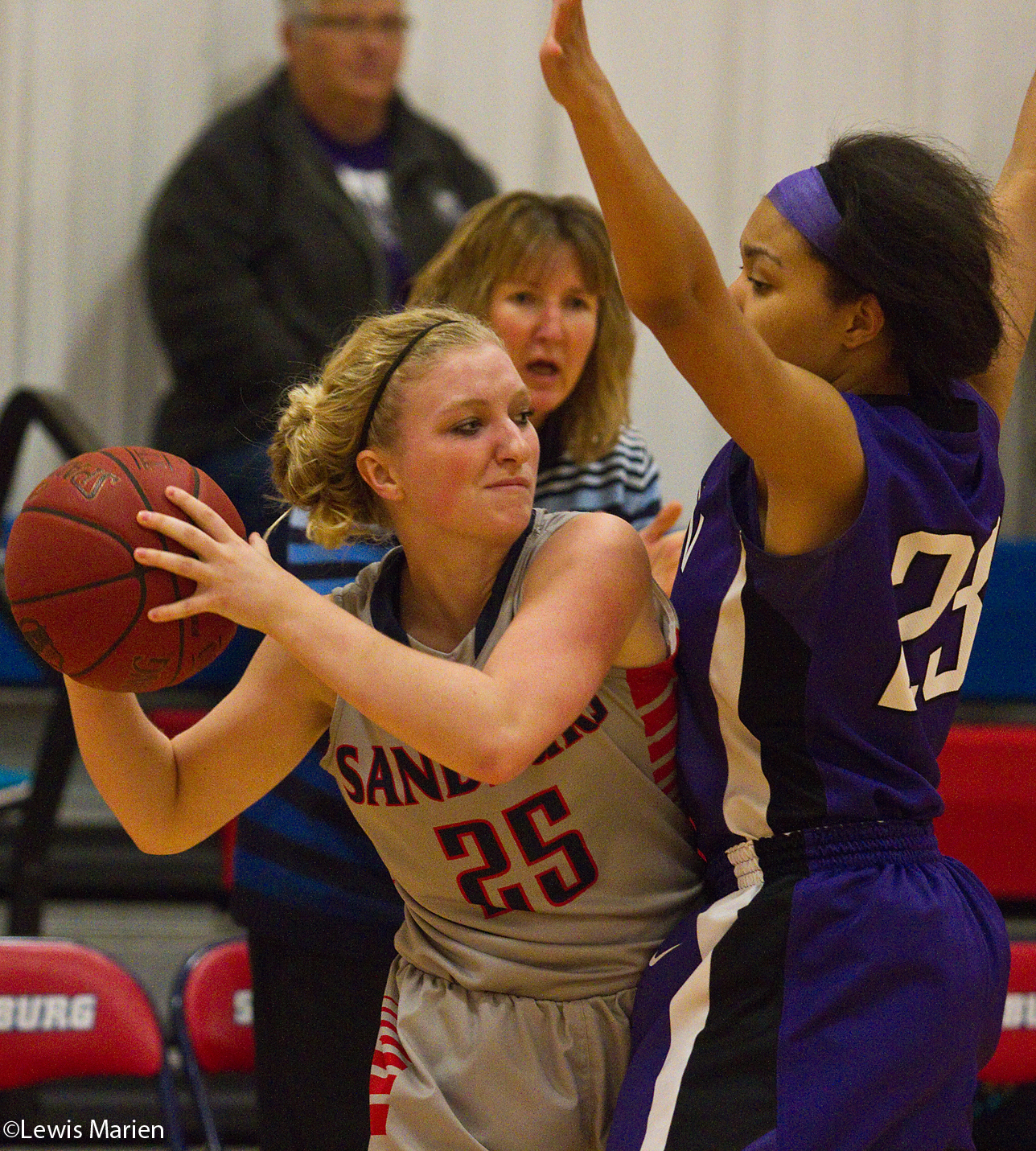 Carl Sandburg College's Kassi Henrekin tries to elude Lincoln College's Ashanti Barnett on Nov. 20 during the Chargers' game with the Lynx at Carl Sandburg College's John M. Lewis Gymnasium. The Chargers won 81-55.
