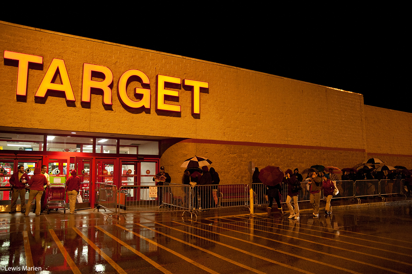 People and Target employees wait outside of the store's Galesburg, Ill., location prior to the 6 p.m. opening Thanksgiving evening, Nov. 26.