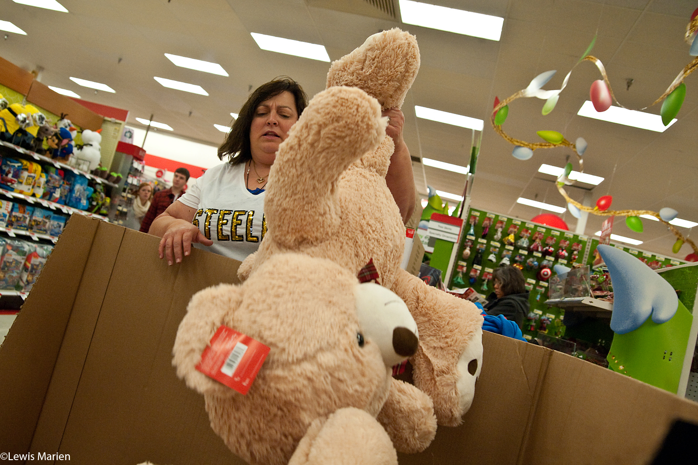 Angie Craig of Wataga eyes a 36-inch giant plush bear while shopping on Thanksgiving evening, Nov. 26, at Target in Galesburg, Ill.