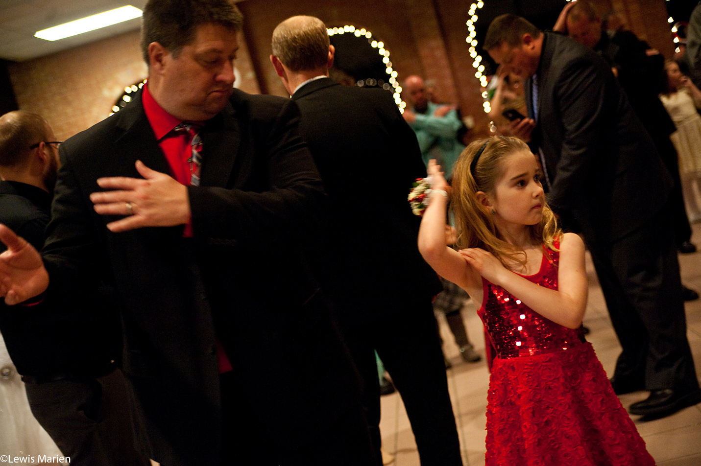"""Richard Hogan,of Galesburg, Ill., dances to the """"Macarena"""" with his daughter Alexis, 7,during the 27th annual Daddy-Daughter Candyland Ball Dec. 2 at the Lake Storey Pavilion in Galesburg, Ill."""