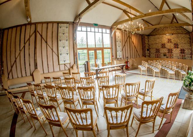Upwaltham Barn set up for a wedding ceremony