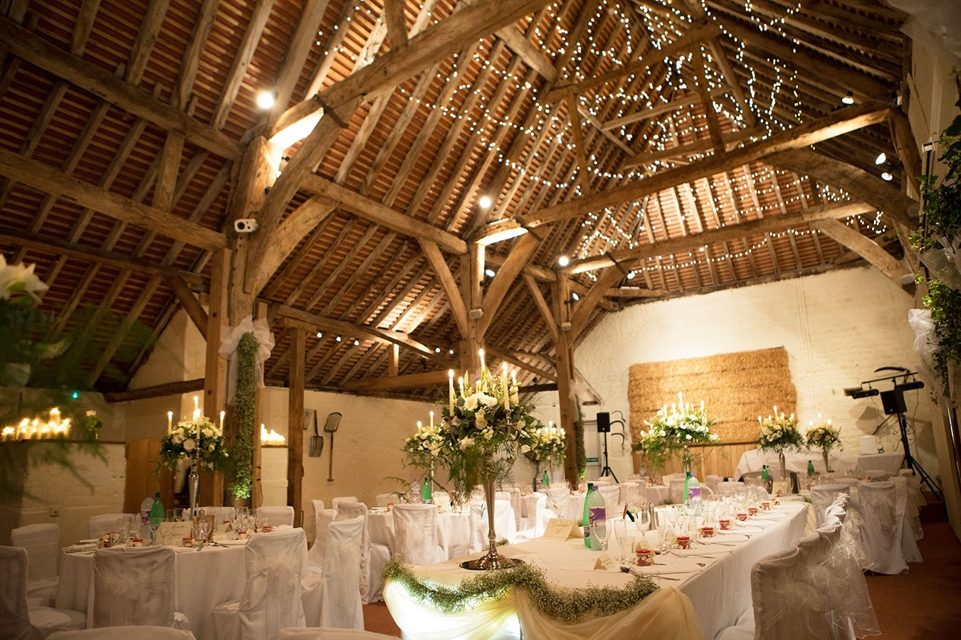 The barn at Pangdean set up for an elegant wedding breakfast