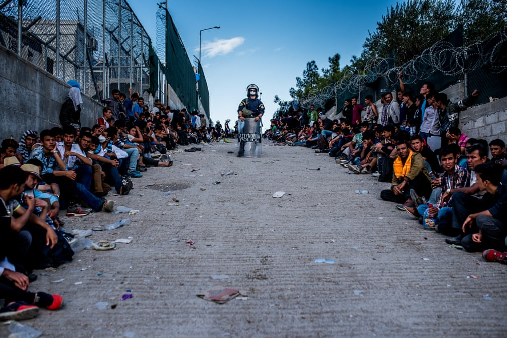 Crossing Borders, Greece, 2015  Refugees waiting in a queue for registration in the Moria camp on the island of Lesbos   Photograph: István Bielik