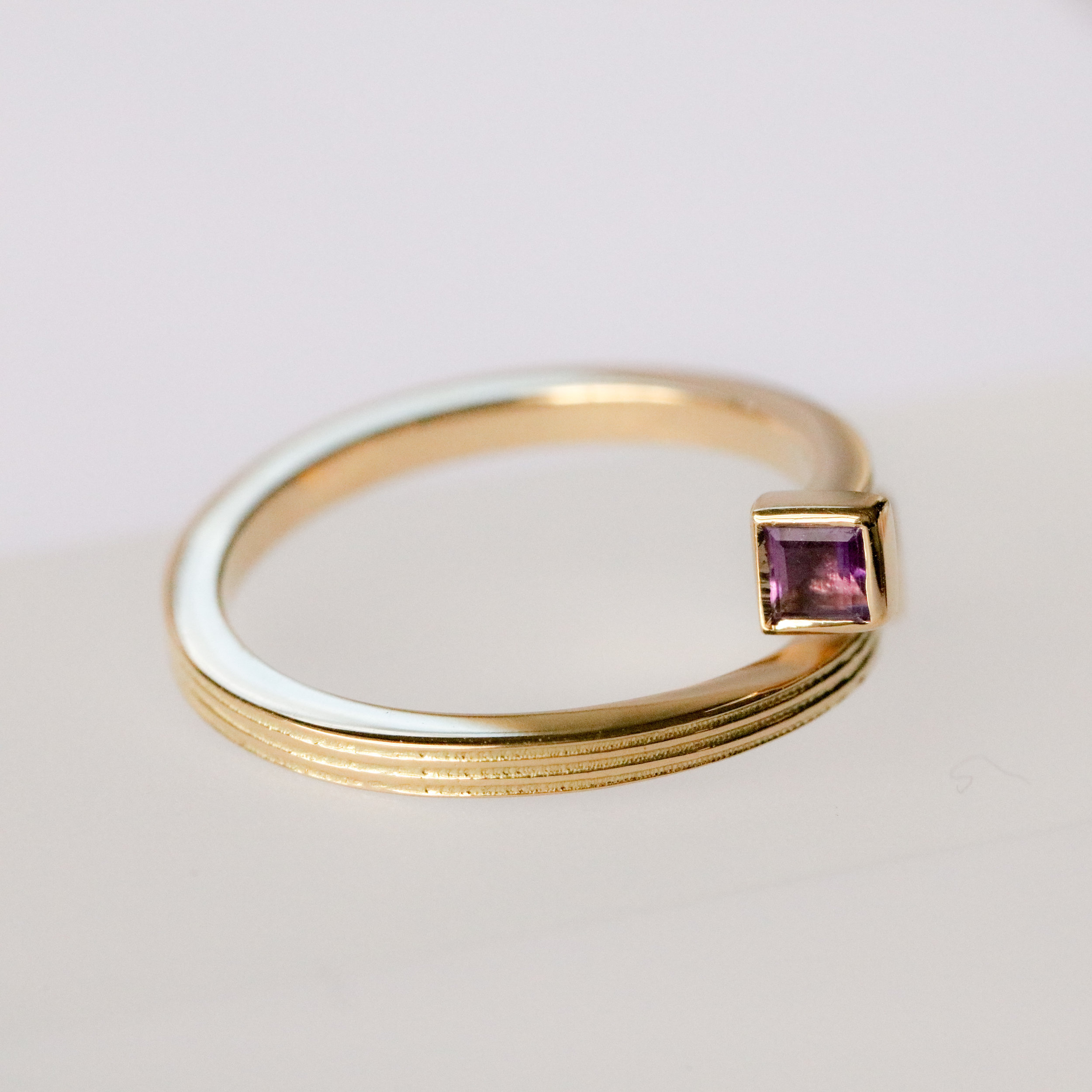 Helical Ring in 18ct yellow gold, set with amethyst