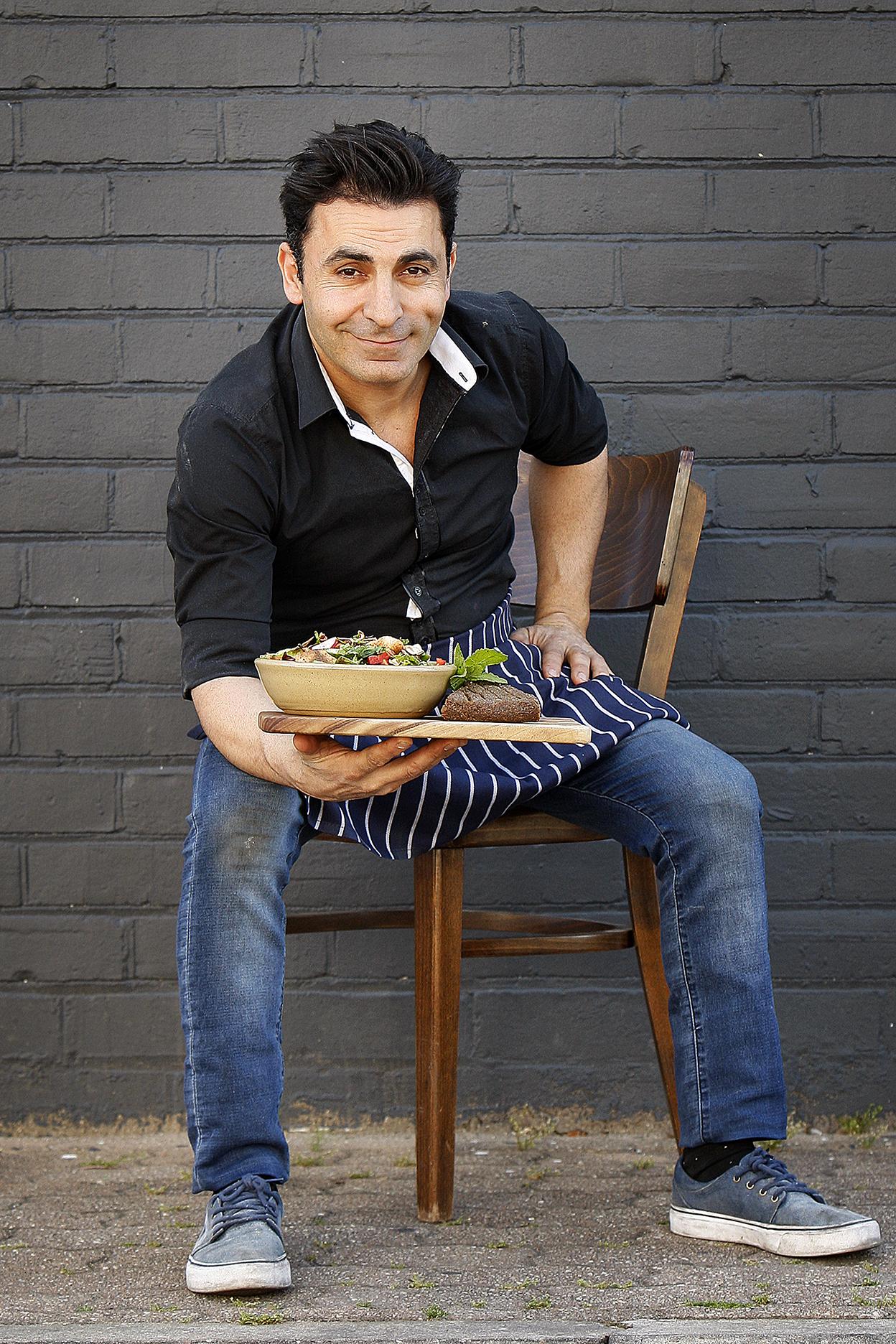 CHP_Export_126302547_Ballaboosta owner Naj Moubayed with some %27Kebbi%27 %26   %27Fattoush%27 salad at his Ad.jpg