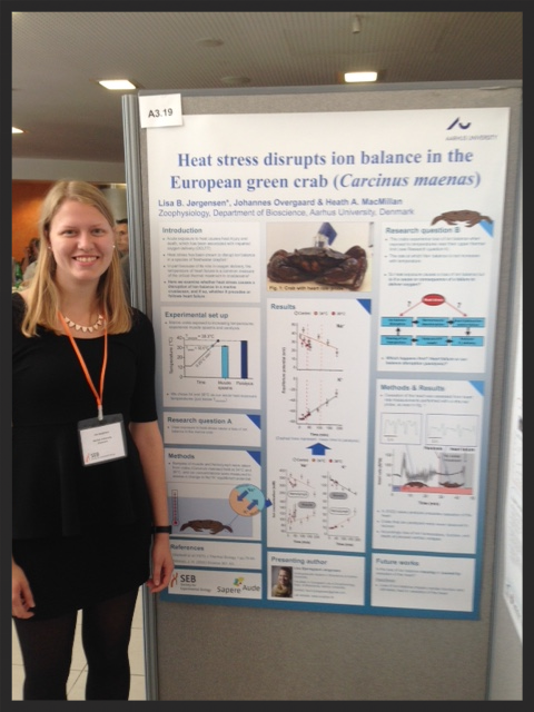 Lisa Jørgensen stands with her awesome poster about the effects of heat stress on ion balance in the European green crab.