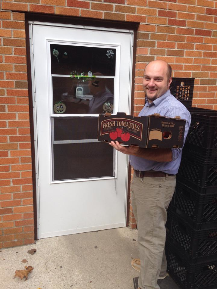 Farm to Table Coordinator, Jason Brashear, helps deliver local tomatoes to a Perry County school