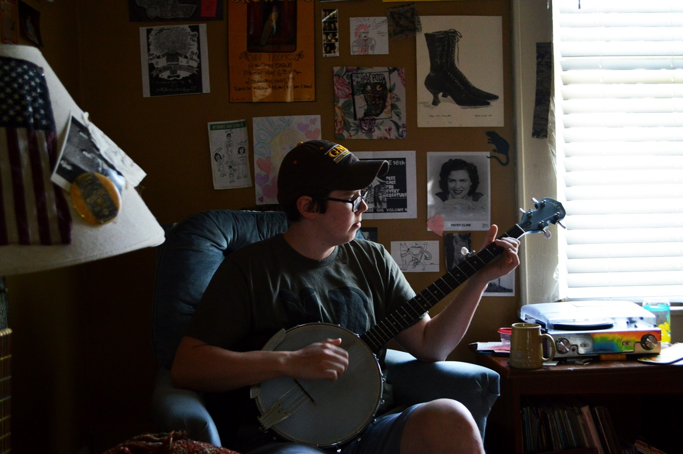 "Kendall playing ""Darlin' Corrie,"" an old Appalachian song, on the banjo. Photograph by Ryan Weisser."
