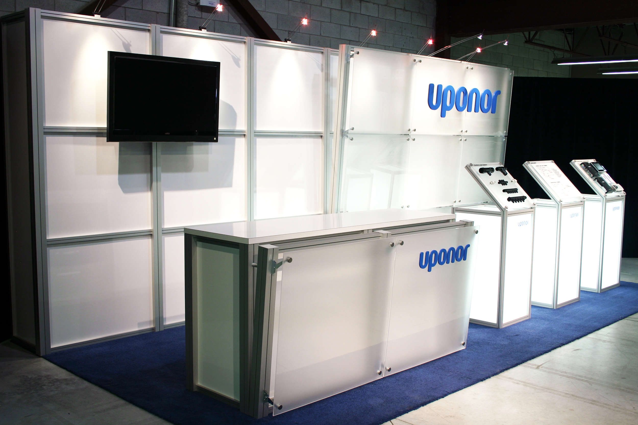 This modern 10' x 20' booth showcases product on glowing pedestals and a clean backwall highlighting their branding