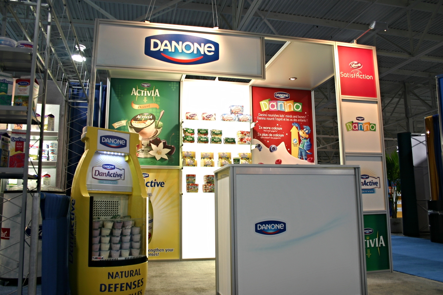 Second trade show photo of Danone's 10' x 10' display rental with printed graphics