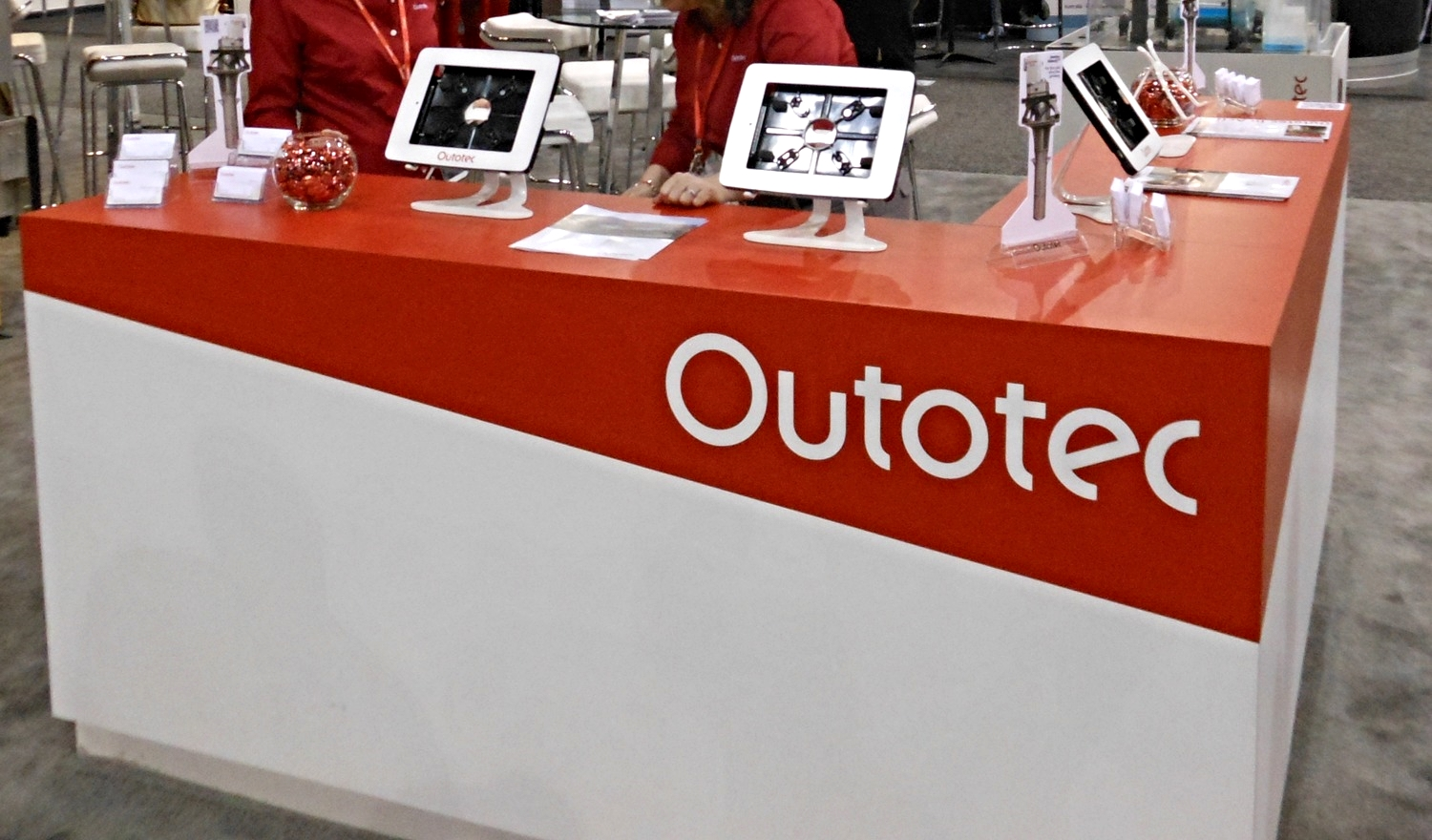 Outotec's exhibit featured a large hanging sign, custom millwork and modern furniture