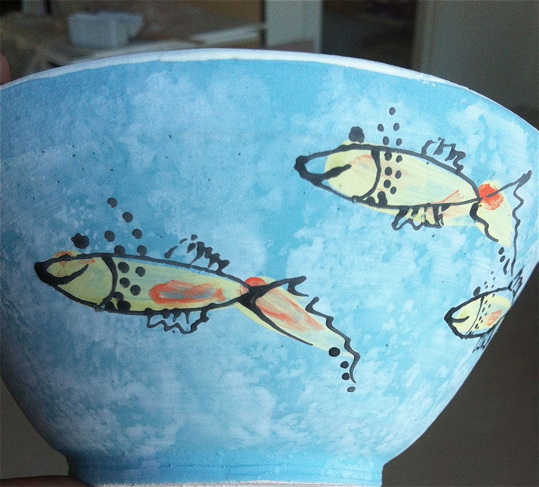 """""""Happy Fish"""" -- Another hand thrown ceramic bowl by Lisa Codella."""