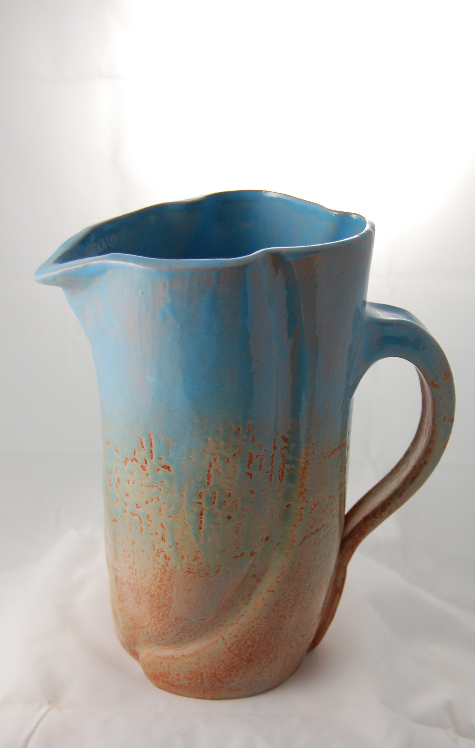 Slab built and altered pitcher. Functional pottery that delights they eye, by Lisa Codella.