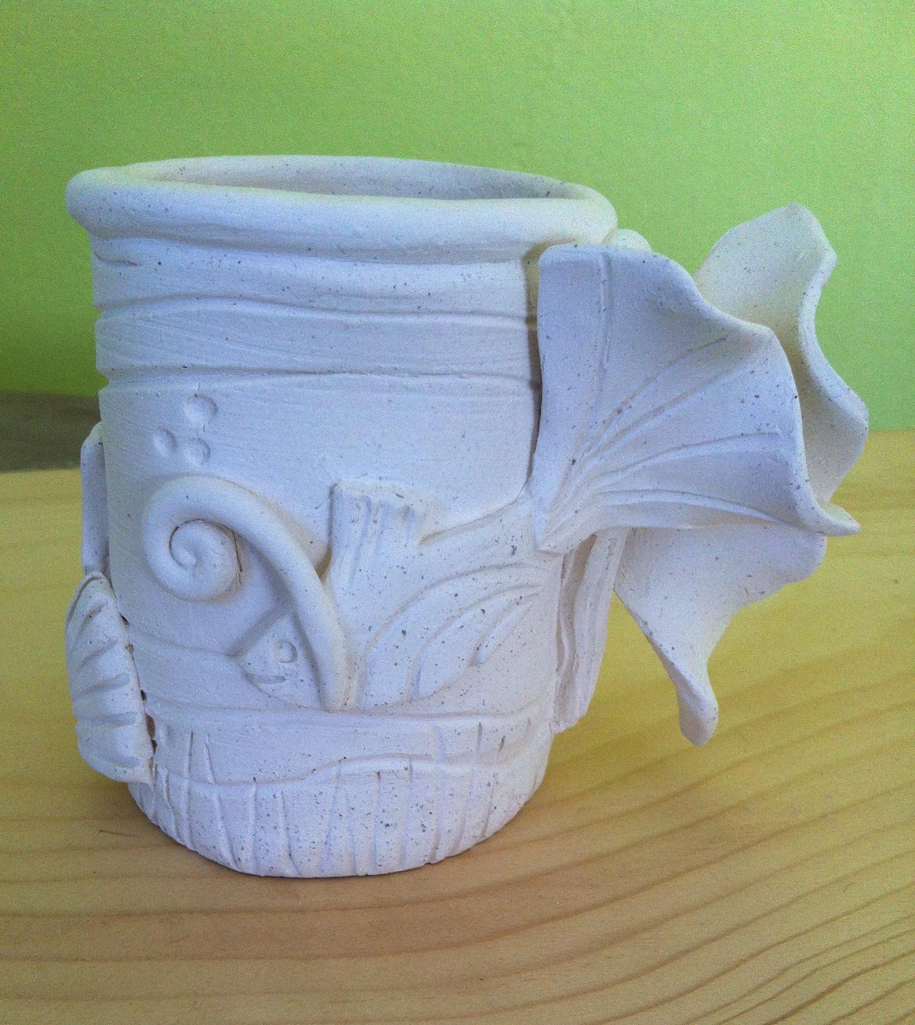 """""""Reef Buddies"""" -- This first in a series of hand built and sculpted mugs is awaiting the next stage in the process: application of glaze."""