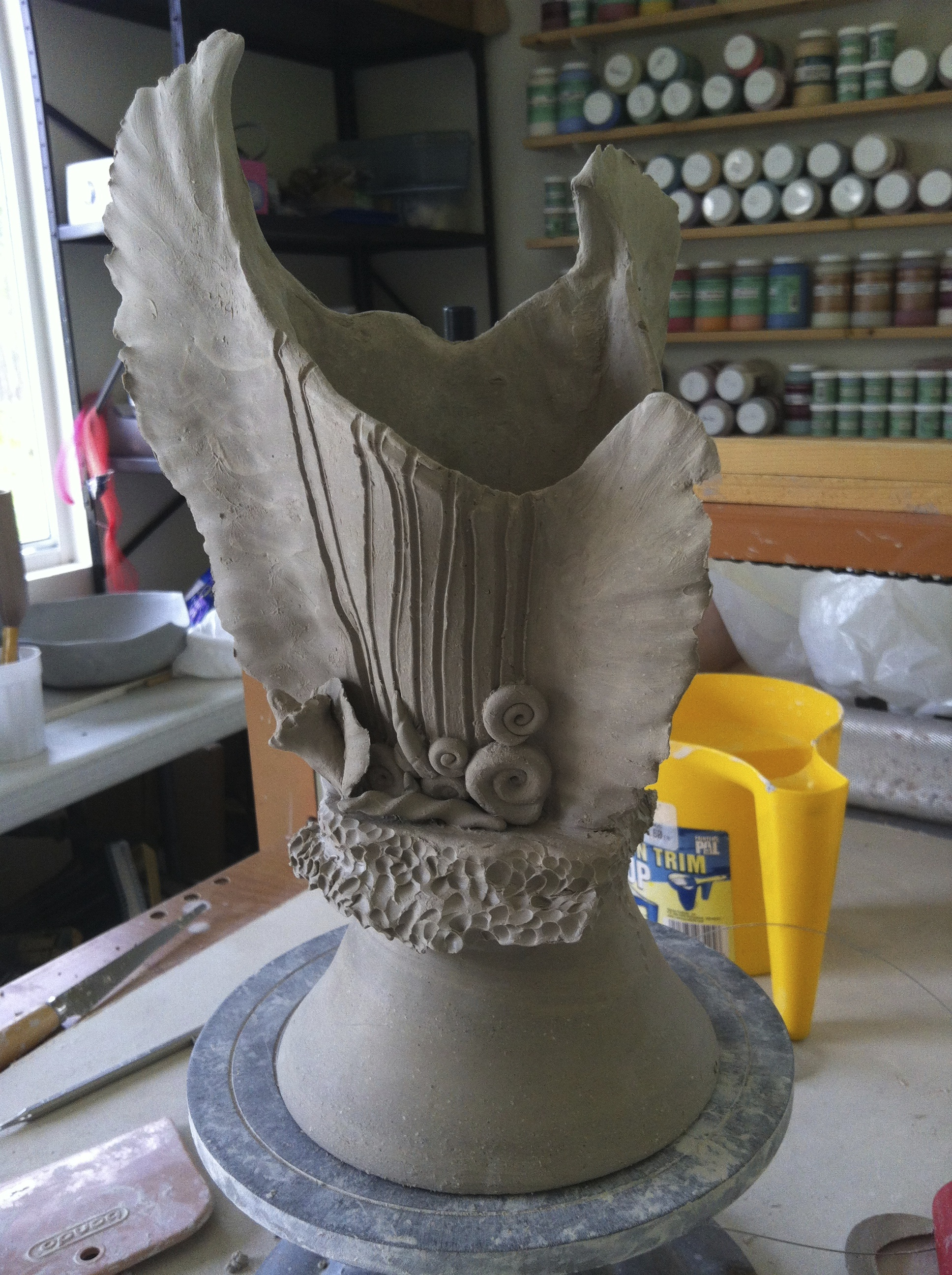 Wheel thrown and handbuilt vase in progress.