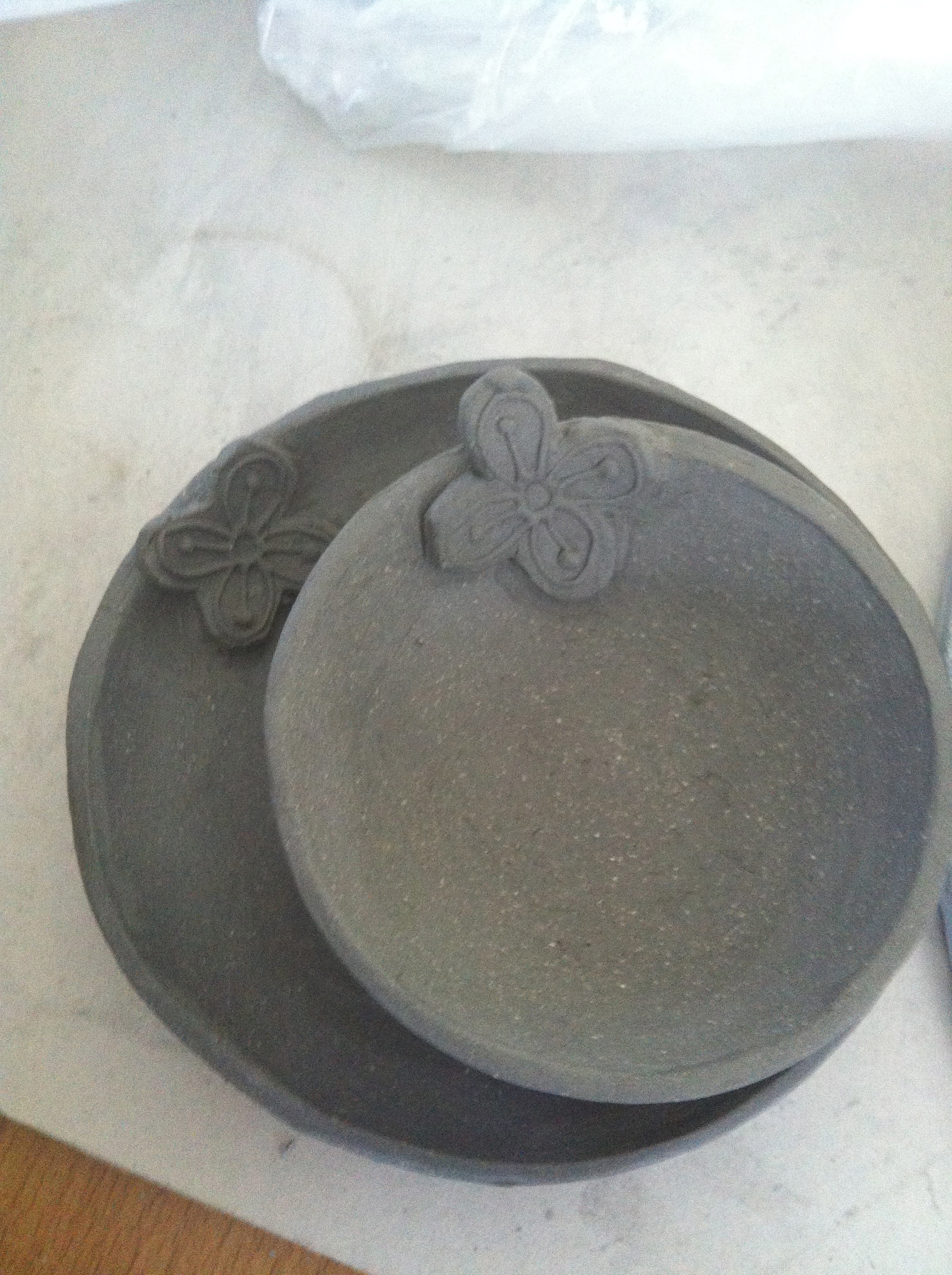 """""""Bese Saka"""" dish --The Adinkra symbol of affluence, power, abundance, plenty, togetherness and unity is attached to a wheel thrown dish for a raised effect. These dishes will be glazed in turquoise."""
