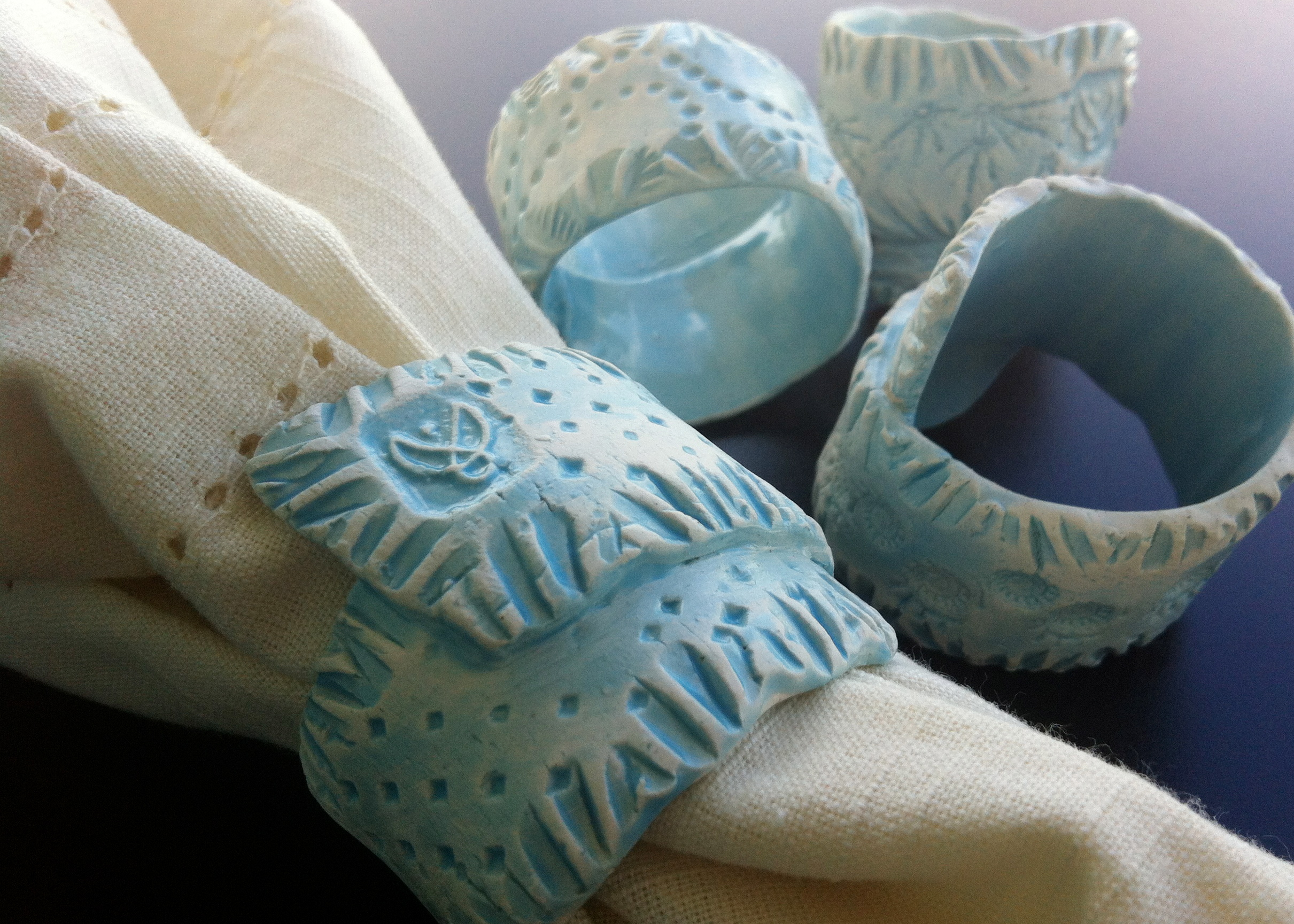 Our napkin rings are hand stamped with many layers of texture using original stamp designs made by hand in the studio, and shells from the islands of Eleuthera and Grand Bahama.