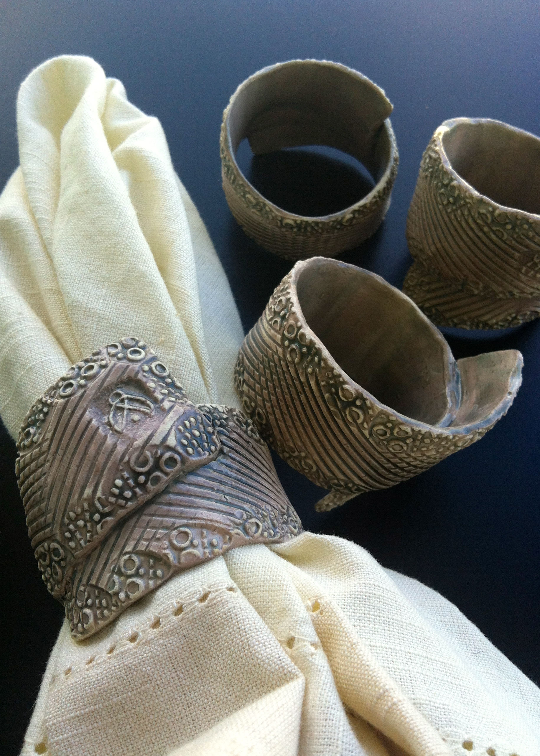 Napkin rings made by hand in The Bahamas at 143 Pottery.