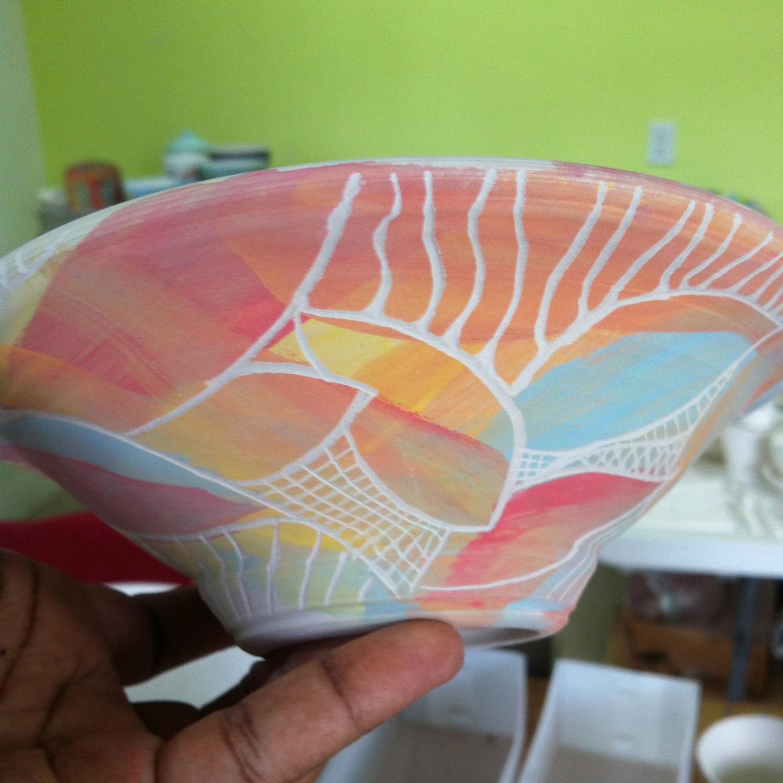 Wheel thrown bowl + brushed on underglazes + sgraffito…next stop: the kiln