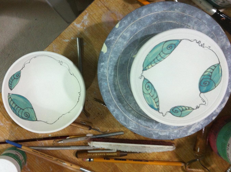 wheel thrown bowls with underglazes and glaze pen.