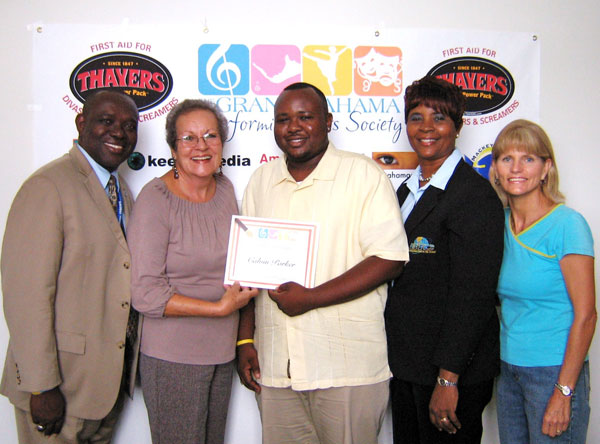 In 2011, Ivy Elden awarded the first scholarship from the Grand Bahama Performing Arts Society to   Calvin Parker Jr.  Shown left-right:   Calvin Parker Sr., Ivy Elden, GBPAS Treasurer, Calvin Parker Jr., Colene Parker and GBPAS Secretary, Colleen Lewis. (Photo: TheBahamasWeekly.com)
