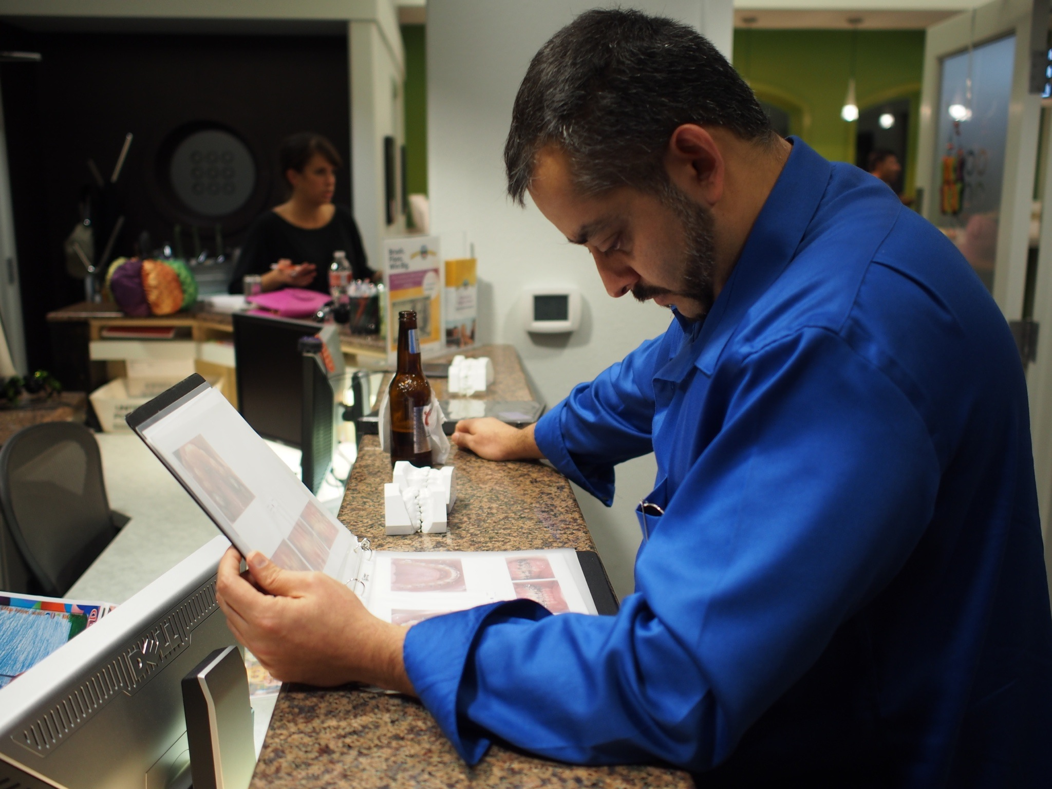 TOSC Guest Dr. Vishnu Raj looks over a TOSC notebook to see how they are prepared for the Annual Meetings.