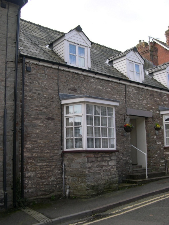 Number 5 Bear Street is to the left of the doorway