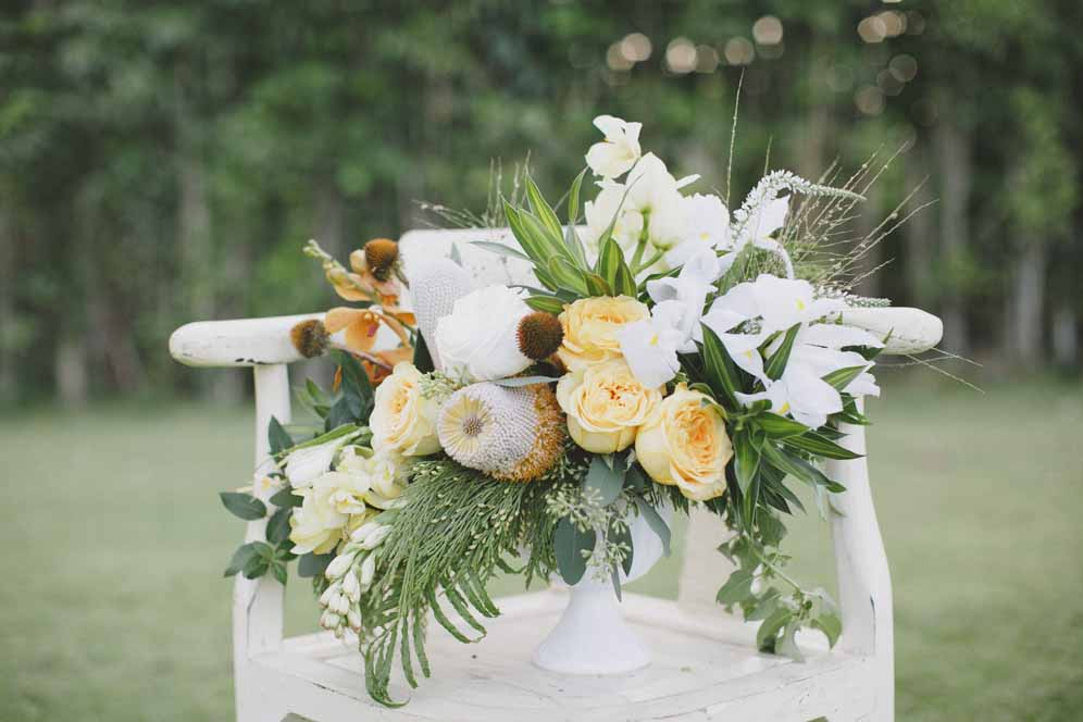 yellow and white boho centerpiece by Passion Roots | Crystal Chanel Photography | Oahu, Hawaii