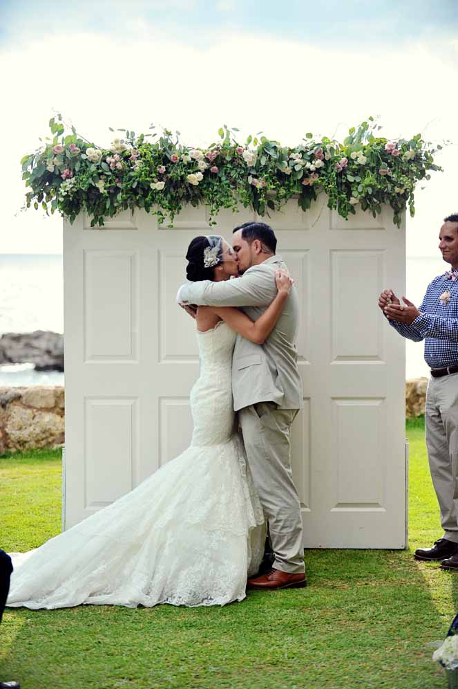 unique double door floral arch  design by passion roots | john hook photography | Oahu, Hawaii