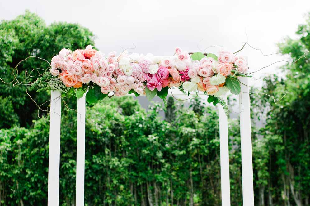 Pink Ceremony arch floral design by Passion Roots | Ashley Goodwin Photography | Oahu, Hawaii