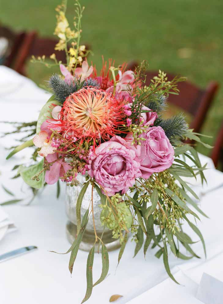 tropical protea and foliage centerpiece by Passion Roots | Oahu, Hawaii
