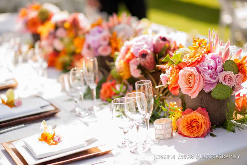 tropical orange and pink centerpieces by Passion Roots | Oahu, Hawaii