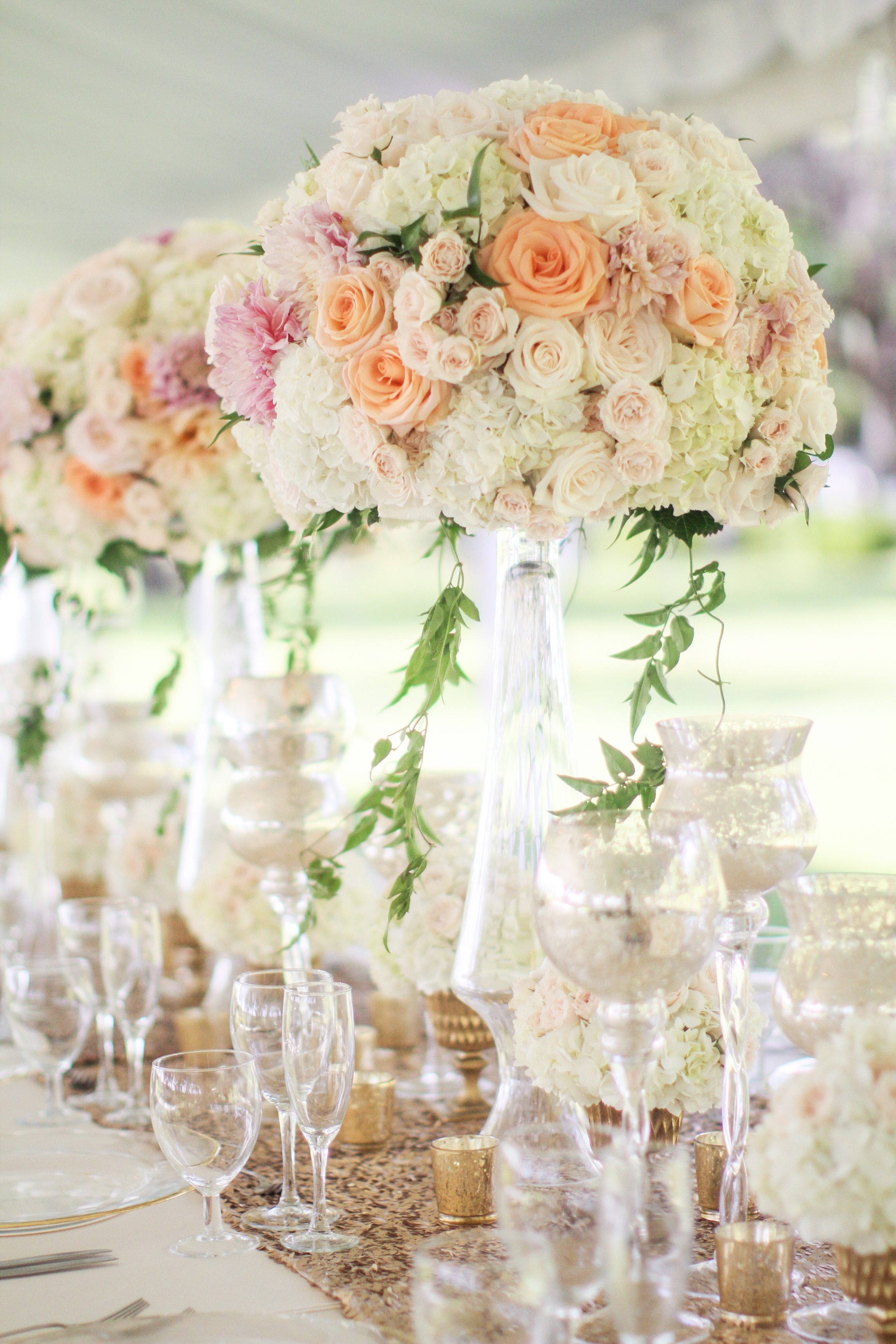 peach, pink tall centerpiece with foliage by Passion Roots | Frank Amodo Photography | Oahu, Hawaii