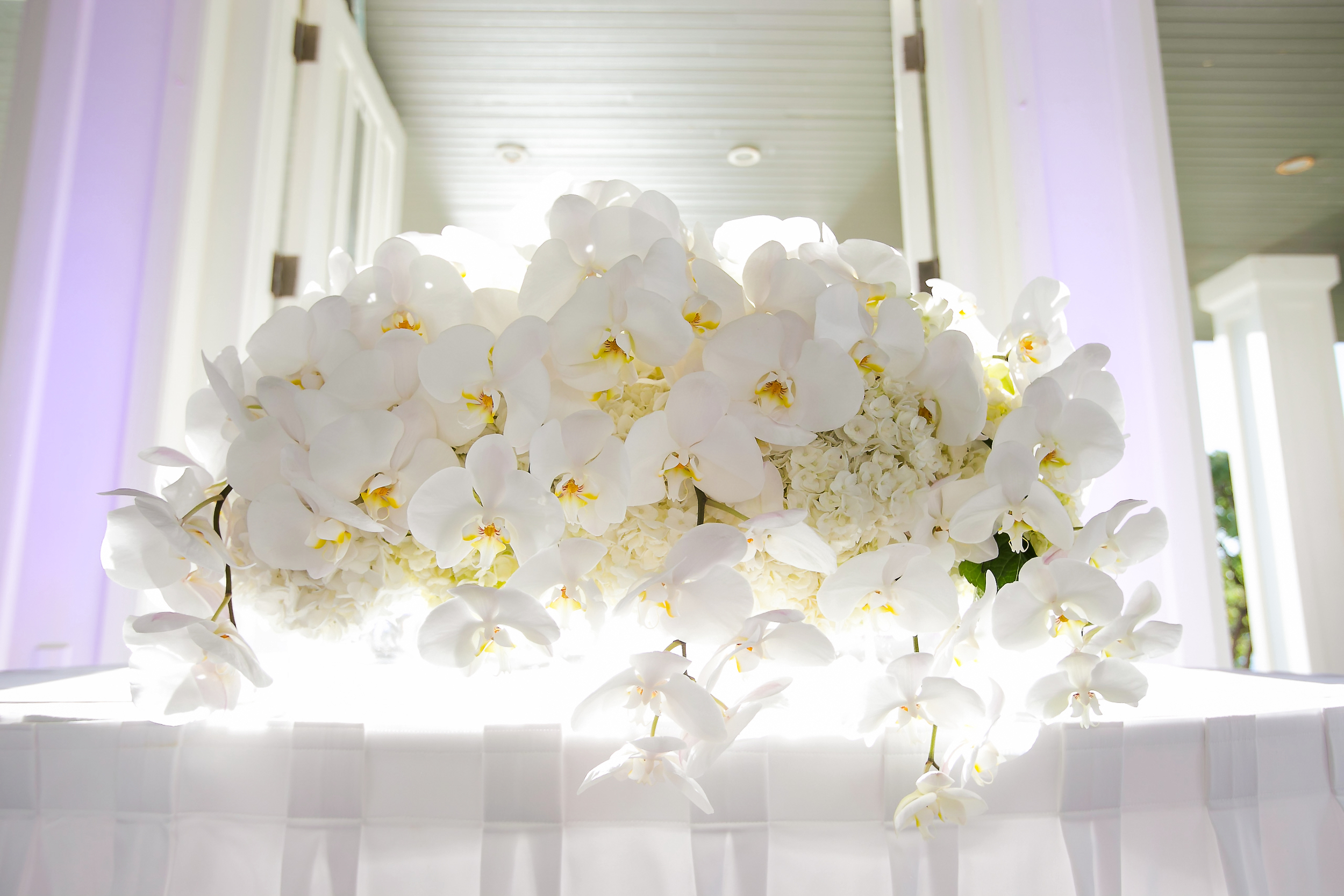 white orchid centerpiece by Passion Roots | Frank Amodo Photograhpy | Oahu, Hawaii