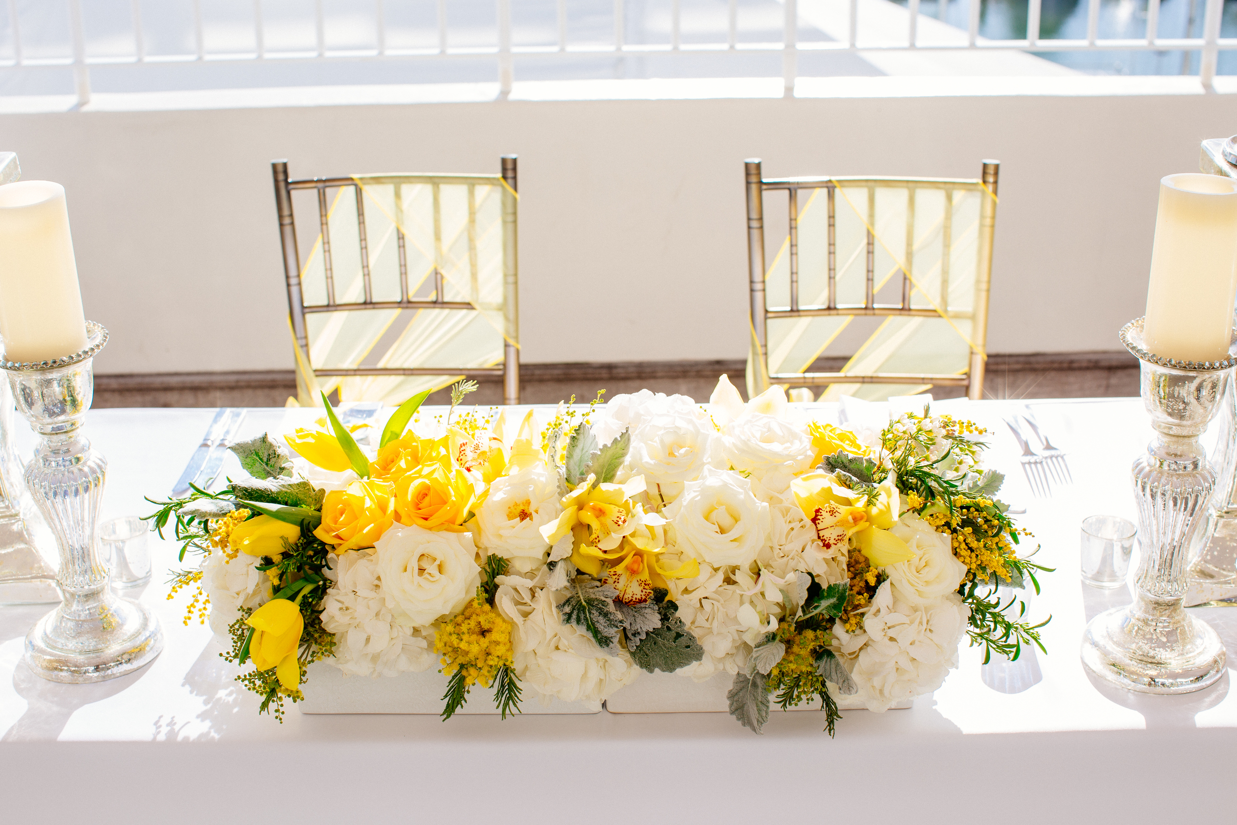 yellow and white sweetheart table arrangement by Passion Roots | Chrissy Lambert Photography | Oahu, Hawaii