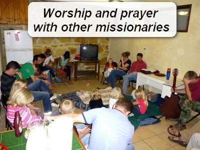 praying with missionaries.jpg