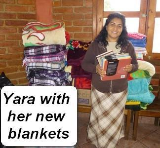 yara with her books blankets and sheets.jpg