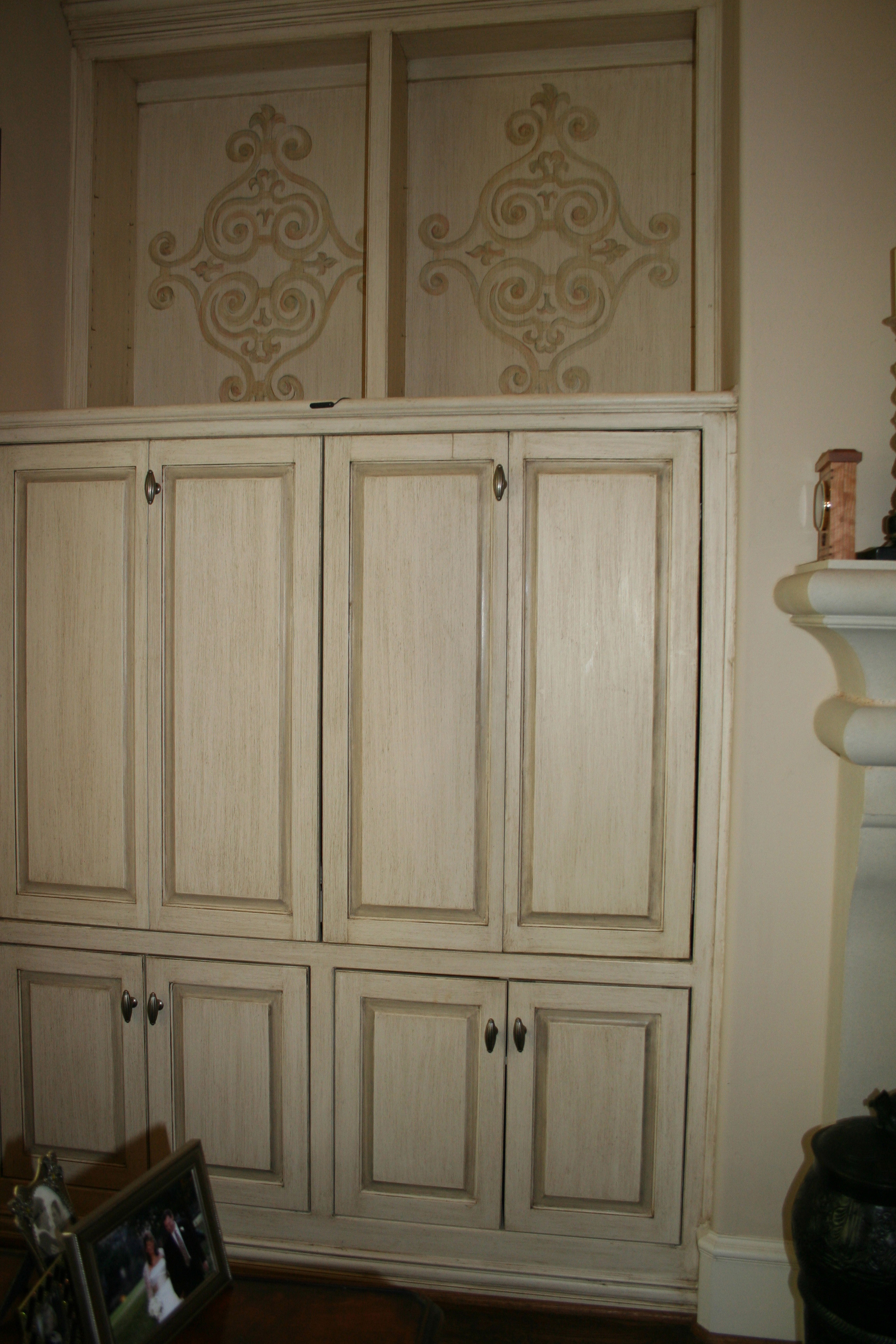Custom hand painted patterns on cabinet doors