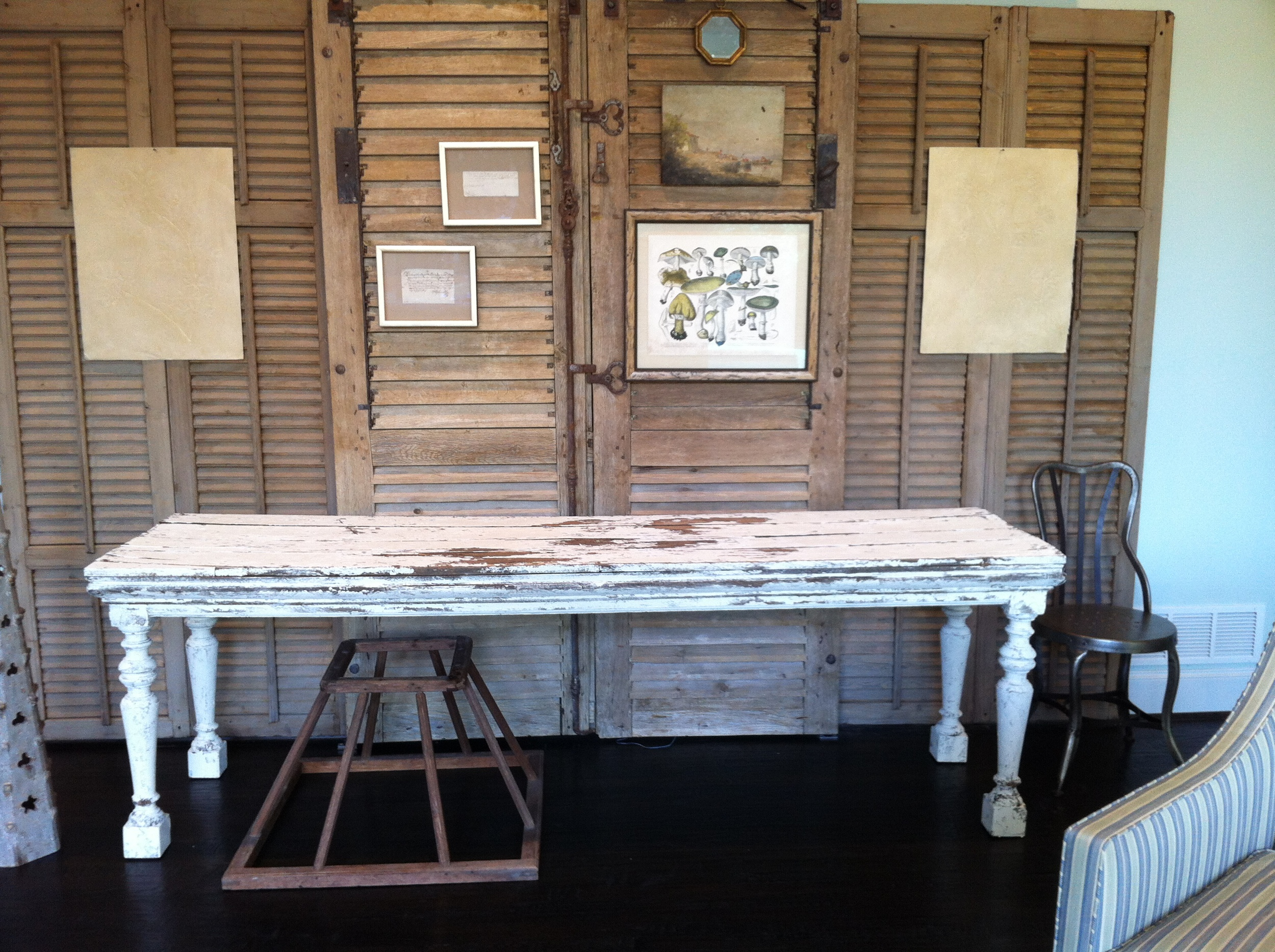Painted finish on antique shutters and large table