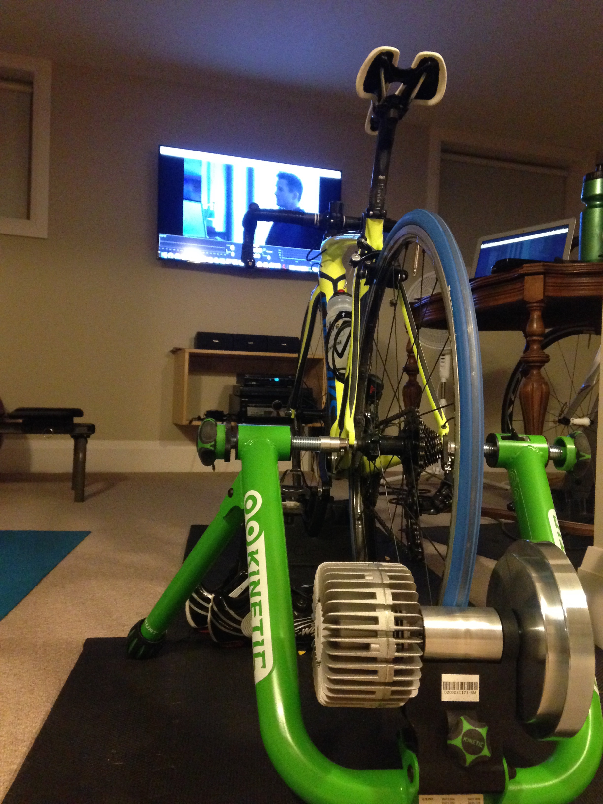 Kurt Kinetic Road Machine &  Trainer Road  software playing over top of Netflix on TV.