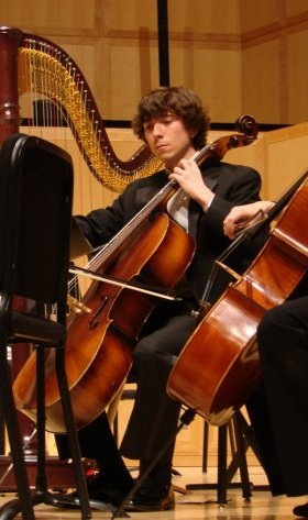 Dylan playing the Cello in the Campus Symphony at the University of Utah