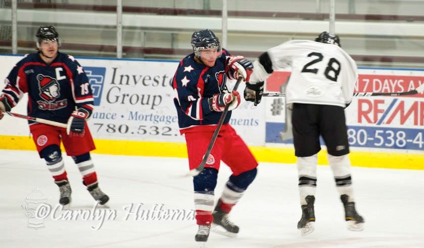 Acting Captain Connor Rose looks on as things get chippy in Grande Prairie on Thursday. (Photo credit: Carolyn Huttema)