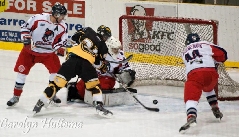 Fort St. John's Blair Karasiuk looks to bury a chance past Steven Ridley, as Canuck defenders Spencer Gover and Brendan Lazinchuk spring into action. (Photo credit: Carolyn Huttema)