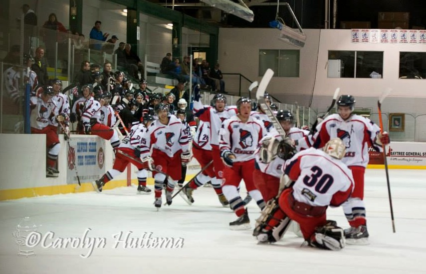 Winning goalie Steven Ridley slides towards a parade of happy teammates after stopping all three shooters in Saturday's 6-5 shootout victory over Beaverlodge. (Photo credit: Carolyn Huttema)