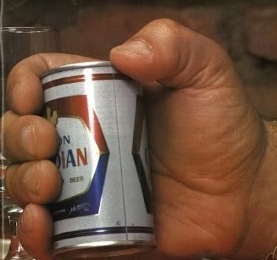 Andre The Giant holding a can of beer.