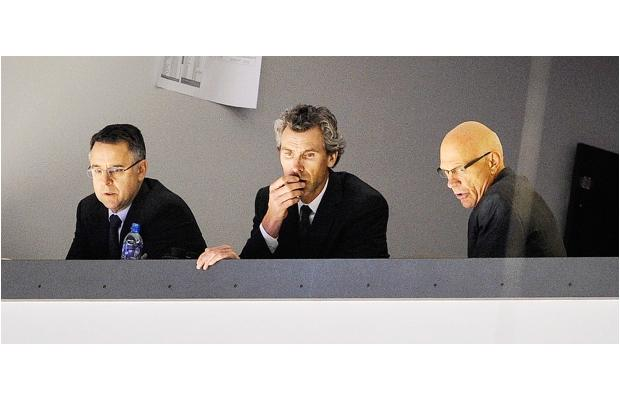 Trevor Linden (center) fired Canucks Assistant GMs Laurence Gilman (L), Lorne Henning (R).