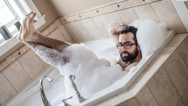 A sampling of Brendon's boudoir modeling. Photo by Masika May.