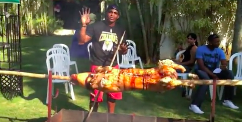 Yoenis Céspedes, pictured with his previous pig.