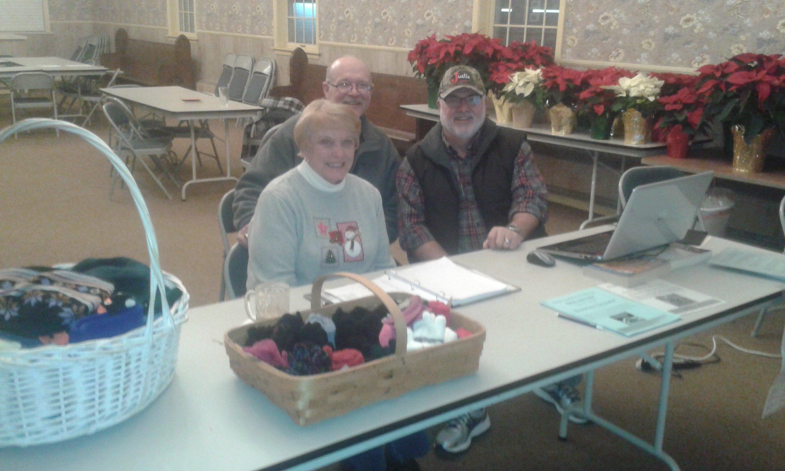 Karen Metsker, Rob Holl, and Fr. Thomas Haynes: NFP distribution day at St Thomas' Plymouth