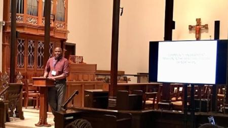 2018-04-20 Missional Voices - Adrien Niyongabo presenting.jpg